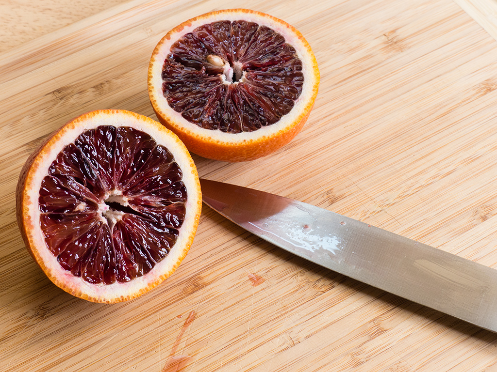 Two halves of a freshly cut blood orange