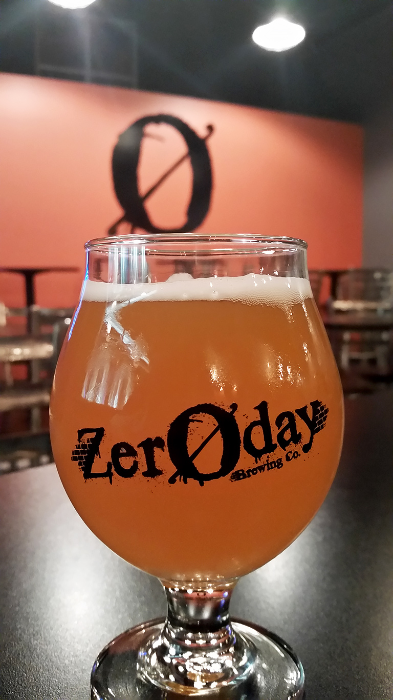 A glass of beer inside the Zeroday Brewery tasting room